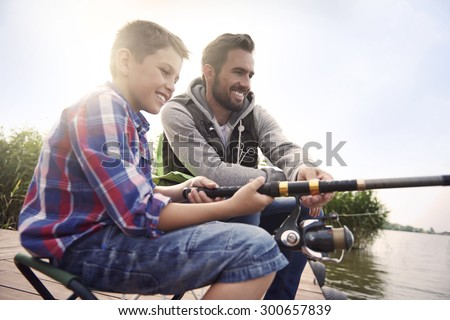 Fishing by the lake is our common passion - stock photo