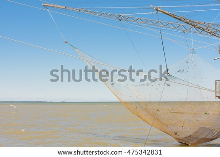 fishing cabin with net, blue sky