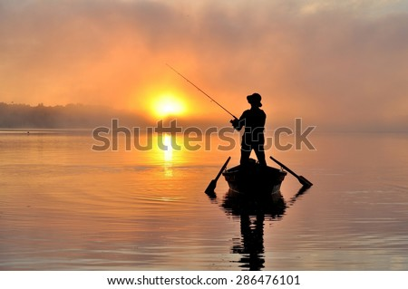 Fishing early in the morning - stock photo