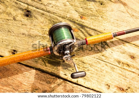 Fishing equipment on the floor. - stock photo