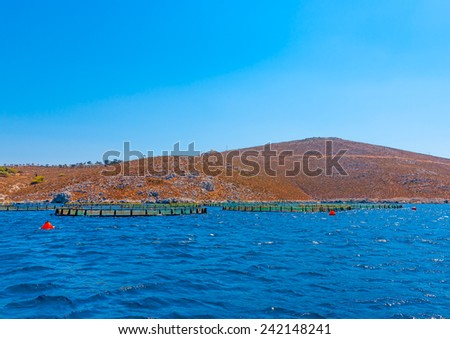 fishing farm out of the Vathi village in Kalymnos island in Greece - stock photo