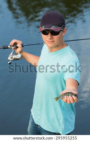 Fishing, fishing on the river. Spinning fishing - stock photo