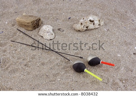 Fishing floats in the sand