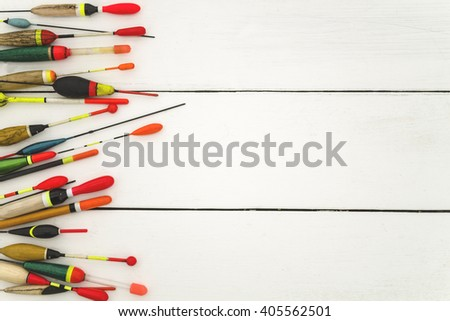 Fishing floats old and new, on a wooden surface in white, lined to the left, a place for an inscription - stock photo
