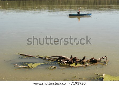 Fishing from little boat - stock photo