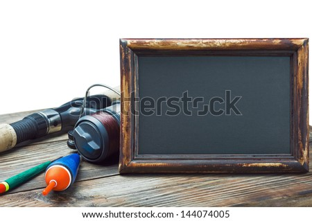 fishing gear and blackboard isolated on white background - stock photo