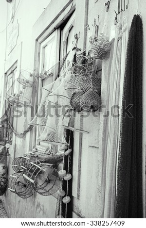 Fishing gear for sale. Portugal. Aged photo. Black and white. - stock photo