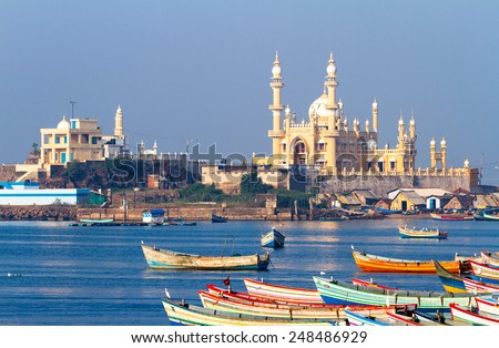 fishing harbour with mosque in the background (Arabian Sea, Kerala, India) - stock photo