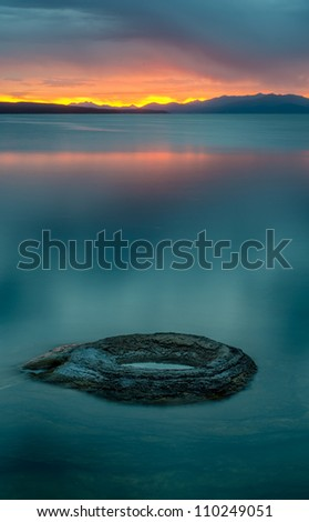 Fishing Hole at dawn at the West Thumb of Yellowstone Lake in Yellowstone National Park, Wyoming - stock photo
