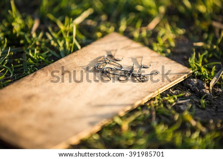 fishing hooks, fishing background, grass, sunlight, backdrop, Outdoors, - stock photo