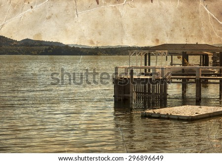 fishing hut on the Clear Lake. Summer day background. Landscape with river.