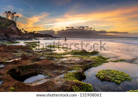 Fishing in Maui at sunset, Hawaii, USA. - stock photo