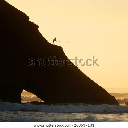 Fishing in Morocco. Natural arch on Legzira Beach.