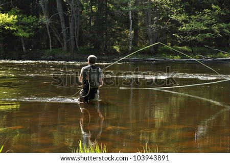 Fishing in river - stock photo