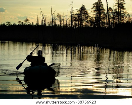 Fishing in the late evening - stock photo