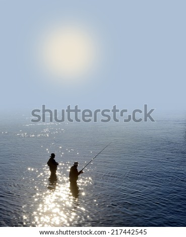 Fishing in the morning fog - stock photo