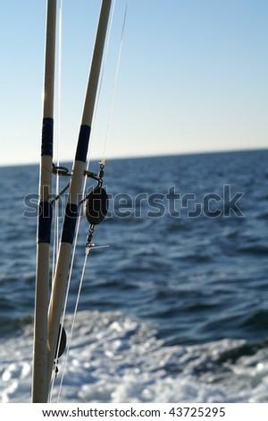 Fishing in the ocean - stock photo