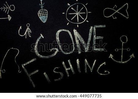 fishing,inscription in chalk on a black background,fishing accessories - stock photo