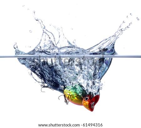 Fishing lure splashing into water isolated on pure white - stock photo