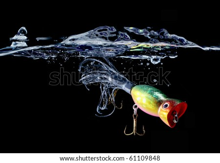 """Fishing lure suspended in water Concepts """"take the bait"""" """"hooked"""" """"do not get hooked"""" """"catch them out"""" etc - stock photo"""