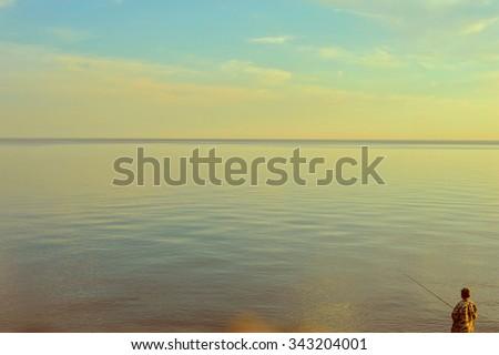 Fishing man at beauty sunrise - stock photo