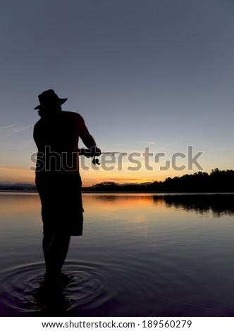 fishing man at sunset in batemans bay - stock photo