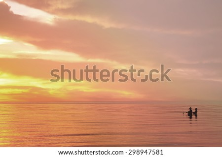 fishing man silhouette on sunset, natural background - stock photo