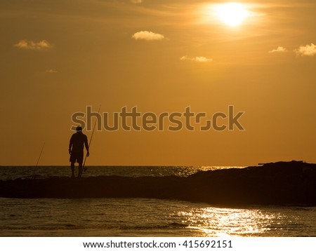 Fishing man with sunset day
