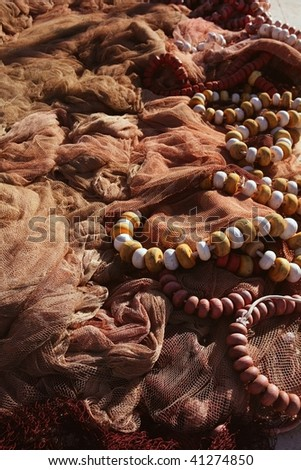 Fishing net and gear for professional fisherman boat, texture - stock photo