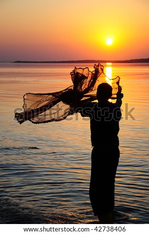 fishing net and sunset - stock photo