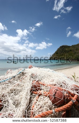 Fishing net and tropical beach background (Martinique Island -  French Antilles) - stock photo