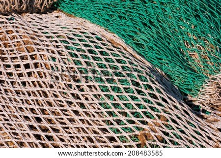 Fishing Net Background / Close up of green, white and brown fishing net - stock photo