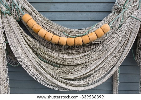 Fishing net hanging on the side of a fishing stage. - stock photo