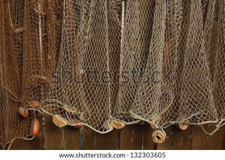Fishing net is hanging on the wall - stock photo