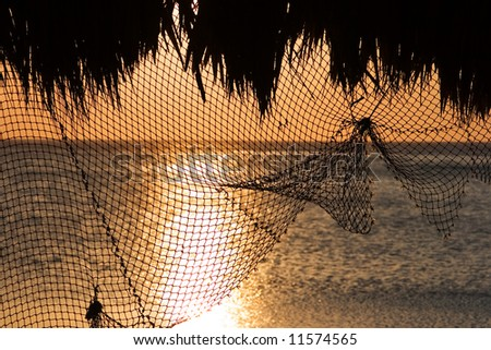 Fishing net used as a decoration in an ocean side restaurant. - stock photo