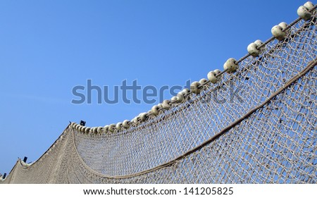 Fishing net with blue sky in background