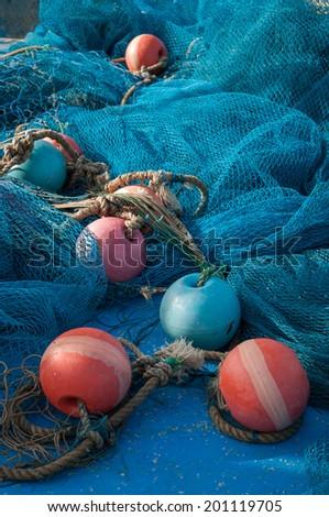 Fishing nets and buoys - stock photo