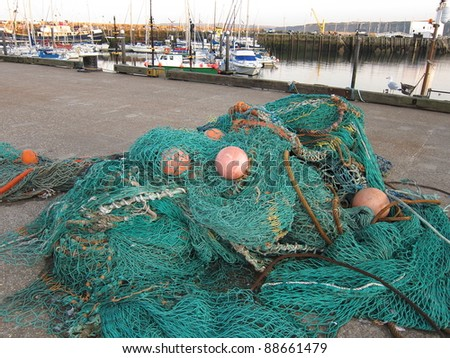 fishing nets in a harbour - stock photo