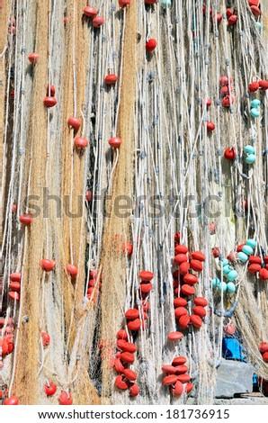 fishing nets in san fruttuoso, italy  - stock photo