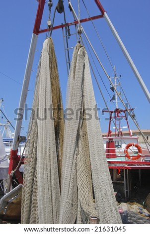 Fishing nets in the boat - stock photo