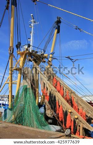 Fishing nets on a mid size trawler - stock photo