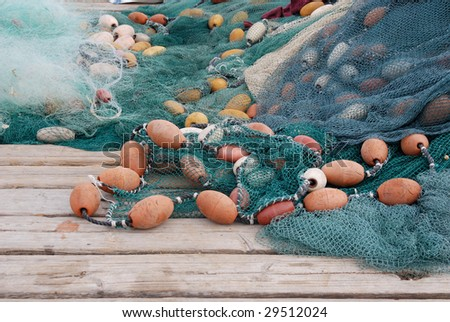 Fishing nets on a wooden pier - stock photo