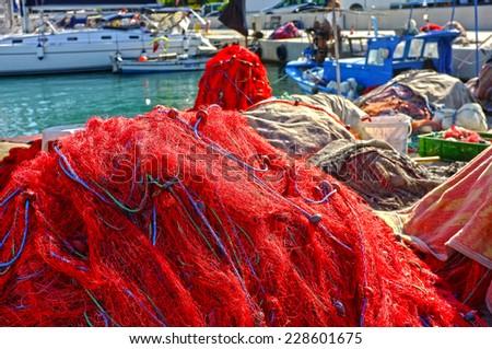 Fishing nets on shore - stock photo