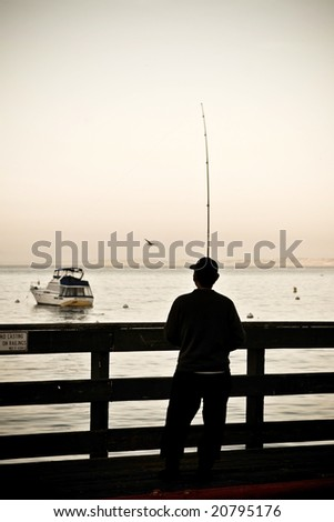Fishing Off The Pier - stock photo