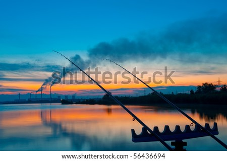 Fishing on a sunset - stock photo