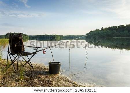 Fishing on Bobiencino lake in north Poland.Pomeranian Voivodeship/Fishing by the lake - stock photo