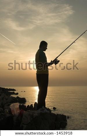 fishing on sunset - stock photo