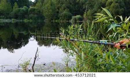 Fishing on the bait lake - stock photo