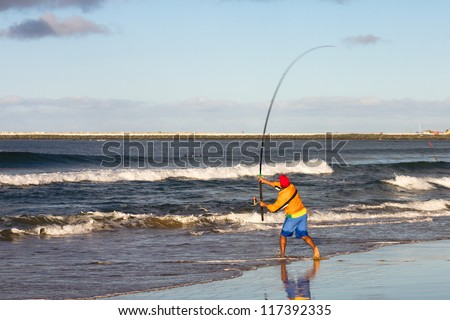 Fishing on the beach in Durban, South Africa. - stock photo