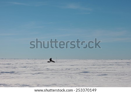 Fishing on the frozen lake